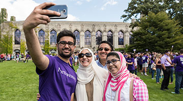 A family taking a selfie at Wildcat Welcome